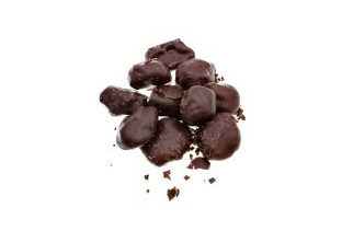 Article_big_23809992-candies-of-dried-plum-in-dark-chocolate-close-up-isolated-on-white-background